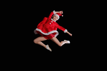 Christmas time, childhood, fairy tale. A young girl wearing a Santa's costume is flying