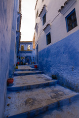 Tipical street of the blue medina of chefchaouen, called also blue pearl for his light blue streets. Stairs in the blue pearl of Morocco, North Africa.