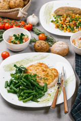 Vegetables served with cutlet on plate