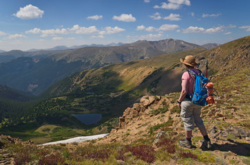 Woman looking at view while hiking on Mount Flora, Colorado