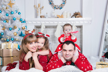 Merry Christmas and Happy Holidays! Xmas Christmas photo of surprised happy family
