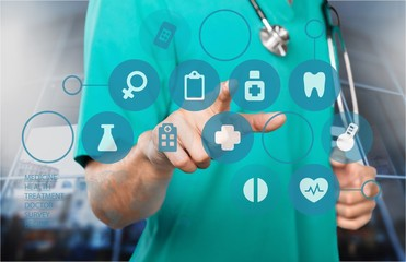 Close-up Doctor with stethoscope and digital icons at hospital