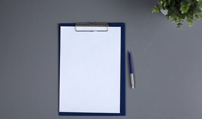 a blank sheet of paper on the table