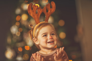 Happy baby on Christmas eve Wall mural