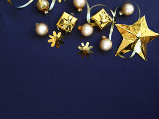 Golden Christmas decorations on black background, flat lay photo, copy space for the text, Xmas greeting card, banner
