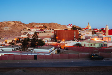 A town at sunset Fotomurales
