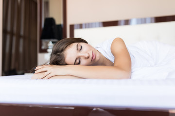 Beautiful young woman sleep on the bed at home