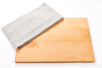 Isolated empty cutting board with cloth