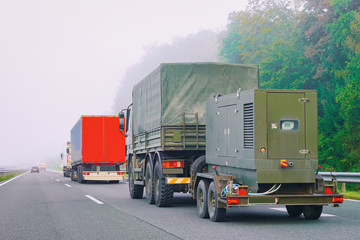 Military truck carrying trailer in road in Slovenia