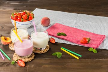 Colourful milkshakes on a wooden table