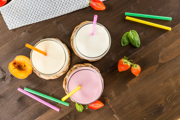 Colorful milkshakes on a wooden table