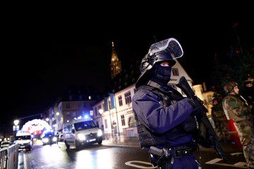 Security forces secure area where a suspect is sought after a shooting in Strasbourg