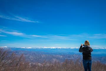 Girl photographing Lovcen National Park