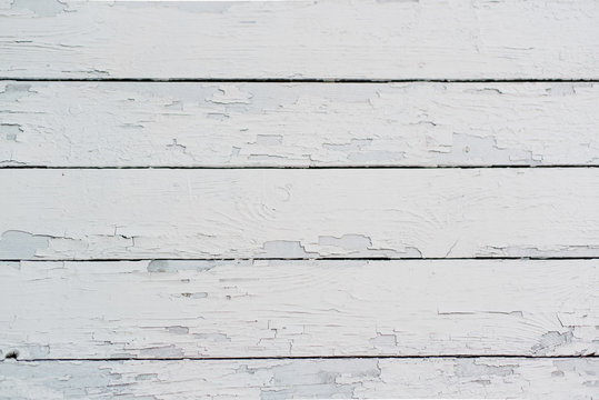 Old wooden boards painted with white paint, which over time rubbed.