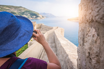 Female tourist taking pictures of Dubrovnik