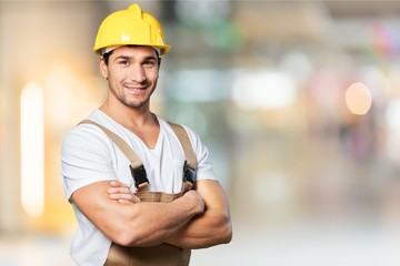 Portrait of happy young foreman with hard hat