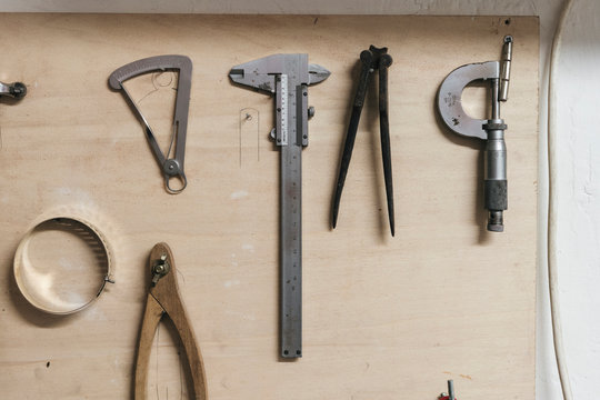 Overhead view of hand tools on wooden table in workshop