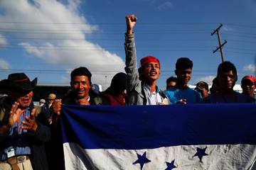 Migrants, part of a caravan of thousands from Central America trying to reach the United States, take part in a demonstration outside the U.S. Consulate in Tijuana