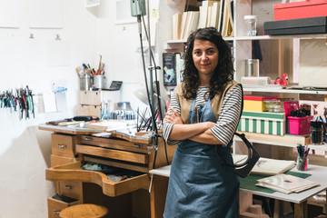 Portrait of smiling artisan standing in workshop