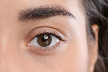 Young woman with beautiful natural eyelashes, closeup view