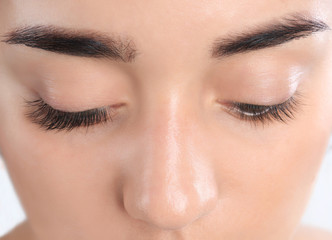 Young woman with beautiful eyelashes, closeup view