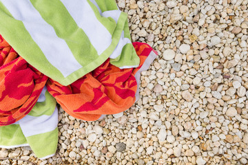 High angle view of towels on stones in backyard