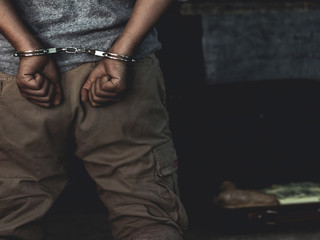 Law and police concept. Arrest drug trafficker with handcuffs.