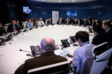 Officials attend an emergency meeting presided over by French President Emmanuel Macron at the Interior Ministry in Paris