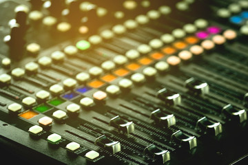 Slide the audio mixer in the control room.