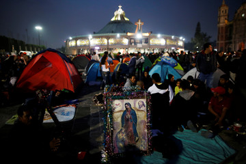 Pilgrims camp at the Basilica of Guadalupe during the annual pilgrimage in honor of the Virgin of Guadalupe in Mexico City