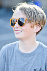 Close-up of boy wearing sunglasses while standing outdoors