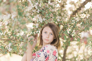 Portrait of girl standing by tree at park