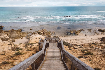 Scenic view of sea with wooden steps at beach