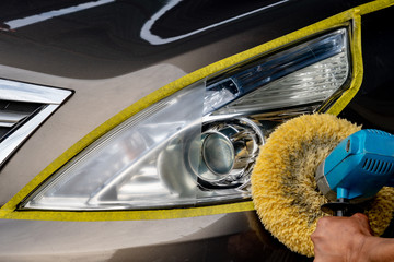 Car headlights with power buffer machine at service station - a series of CAR CARE images. Wall mural