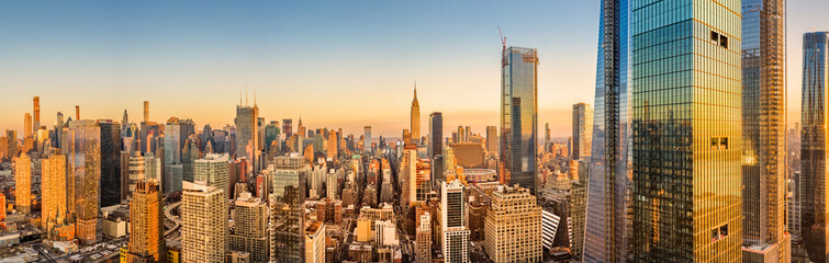Fototapete - Aerial panorama of New York skyline above Hudson Yards midtown Manhattan skyscrapers on a sunny afternoon