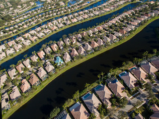Aerial view of houses in row by canals at city