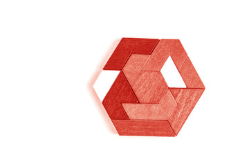 A hexagon tangram puzzle in Living Coral.