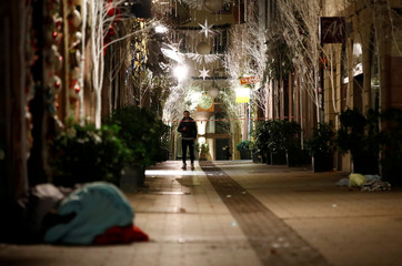 A man walks along a deserted Rue des Orfevres after a shooting in central Strasbourg