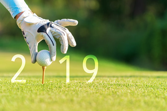 Golfer asian woman putting golf ball for Happy New Year 2019 on the green golf, copy space. Healthy and Holiday Concept..