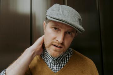 Portrait of man standing in elevator