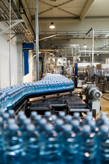 Water bottles on conveyor belt at factory