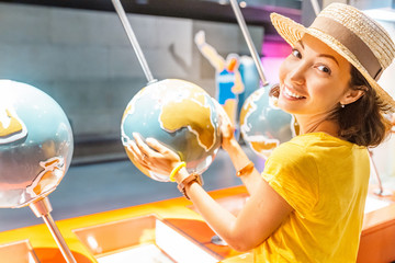 Happy asian woman student with world globe. Travel concept