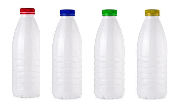 Set of plastic milk bottles on a white
