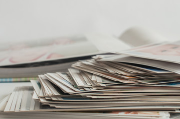Pile of printed photographs lying in disorder.