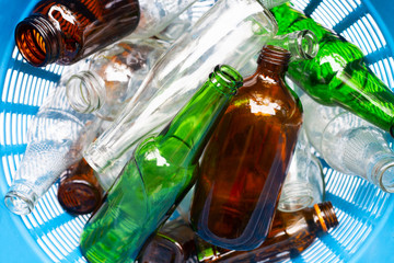 Glass bottles in waste basket.