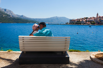 Sensual young couple kissing near the sea