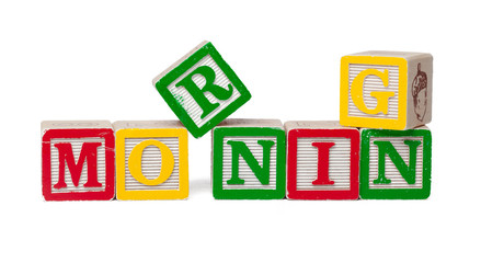 Colorful alphabet blocks. Word morning isolated on white background