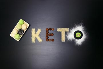 Fat keto peanut butter, cheesecake, matcha balls tea on dark black wooden background. keto protein balls and matcha tea recipes ingredients. it works ketogenic diet.