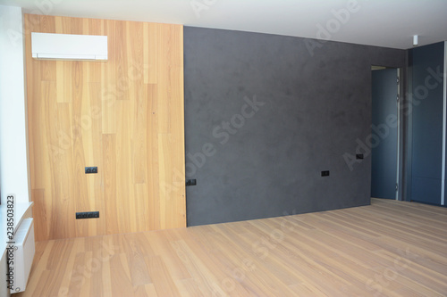 Modern interior house room with wooden floringa wooden wall