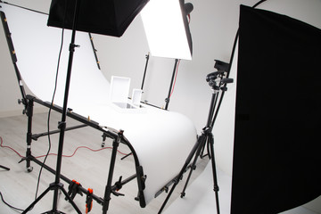 Lighting setup in studio for commercial works such as photo object product with big softbox snoot reflector umbrella and tripods